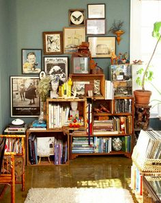 Old wood crate bookshelves...love the entire display!