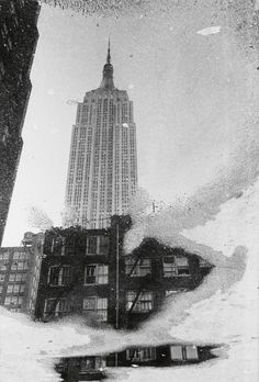 André Kertész Untitled (Empire State in a puddle), New York, 1960's