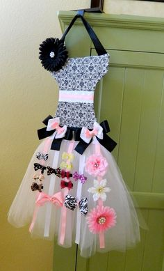 Hairbow holder.  Stefani we could make something like this to display your hairbows and do the other thing for your headbands.