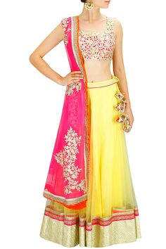 Yellow gota lace lehenga with gold cutwork blouse and pink embroidered dupatta. By Amrita Thakur.