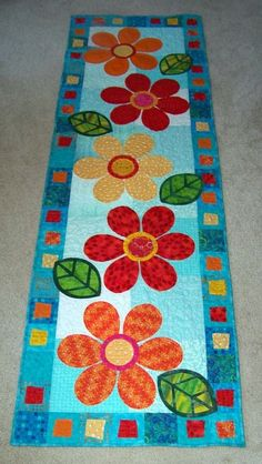 Attic Window Quilt Shop Love this brightly colored table runner!
