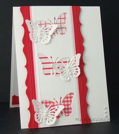 card by Roxie Glaza.... use punched negative portion as background and attach different patterned papers under each opening