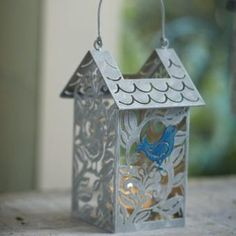 "Bird Haven Votive Lantern P91281 - Cute vine-designed metal house is ""home tweet home"" for one painted blue bird and a glass cup for a votive or tealight candle, sold separately. Handle for hanging. 8¾""h. WAS $15, SALE $6.00 http://www.partylite.biz/legacy/sites/nikkihendrix/productcatalog?page=productdetail&sku=P91281&categoryId=55268&showCrumbs=true"