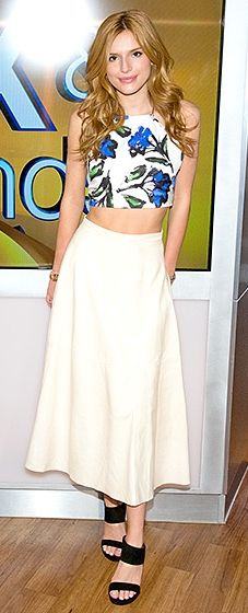 The DUFF actress paired a floral print crop top by Milly with a white miniskirt and black sandals for the appearance.