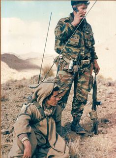In the djebel : a french navy commando officer with his radio-carrier (ex-captured fellagha). See the light US M1.