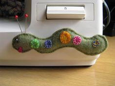 CATERPILLAR handmade sewing machine pin cushion by mzmudcakes