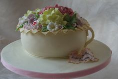 Chamber pot cake full of fondant flowers