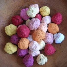 """cute idea for wedding favors.  plantable seed paper """"seed bombs"""" - balls of handmade paper embedded with perennial & annual flower seeds"""