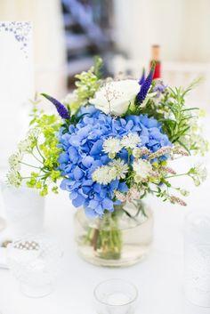 Coastal blue wedding in West Sussex. Blue wedding flowers in jars Photography www.annelimarinovich.com
