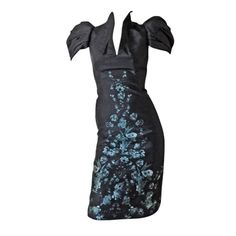 Alexander McQueen 2009 Structural Form Fitting Dress | From a collection of rare vintage evening dresses at http://www.1stdibs.com/fashion/clothing/evening-dresses/