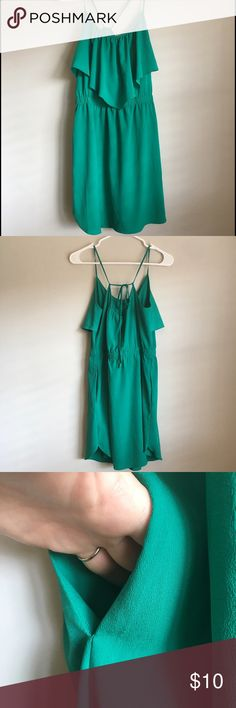 American Eagle Green Mini Dress American Eagle medium green mini dress. Has small stain on skirt towards bottom of hem. Also missing one bead on tie in back. Beautiful dress for spring. American Eagle Outfitters Dresses Mini