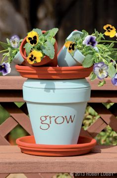 How does your garden grow? For this DIY plant stand, we applied acrylic paint to a clay pot and saucer and glued them together with permanent craft adhesive. Then we sandwiched them between a pair of large unpainted saucers.