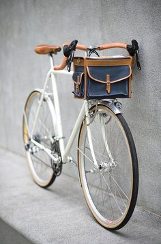 white bicycle with functional bike bag