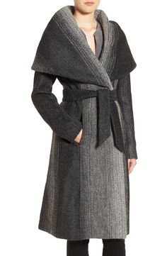 Striated ombré color in a shadowy greytone palette creates an atmospheric effect on this plush wrap coat topped with a dramatic collar that transitions into a roomy hood.