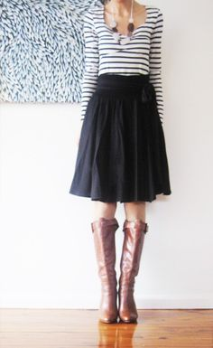 I love stripes right now.  They look cute paired with a flouncy skirt and some riding boots.