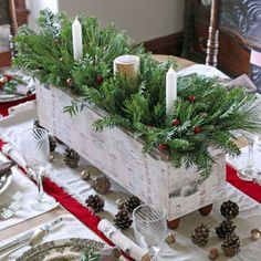 A handmade wood box not only creates a focal point in a dining room, but can also be easily used throughout the rest of the year as table decor.  See more at Fynes Designs. What you'll need: Wood box ($9; amazon.com); Pine cones ($9 for 8; amazon.com); White tapers ($8 for 20; amazon.com)
