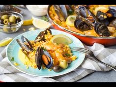 This Spanish Seafood Paella features a saffron infused rice cooked together with veggies and topped with shrimp, squid, and mussels. A perfect seafood dish!