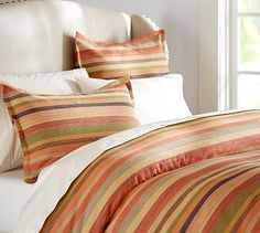 This is a nice look if you prefer more color - still love the hotel white sheets!  Logan Stripe Duvet Cover & Sham #potterybarn
