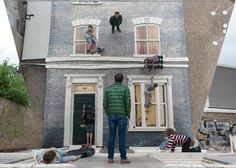 By sitting, standing or lying on the horizontal surface, visitors appear to be scaling or hanging off the side of the building. Sited at 1–7 Ashwin Street, near Dalston Junction, Erlich has designed and decorated the façade – complete with a door, windows, mouldings and other architectural details – to evoke the houses that previously stood on the block. Leandro Erlich: Dalston House opens on 26 June 2013