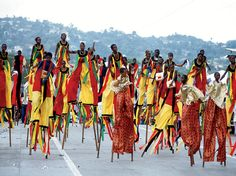 Future Moko Jumbies (stilt walkers) of Trinidad's Carnival practice their craft at Dragon Keylemanjahro School of Arts and Culture