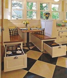 Breakfast nook with awesome under-the-seats drawers. I think a combination this, drawers on the backs of the seats, and lift-up seating storage would be awesome and still fit our small dimensions, as this would be pulled too far out into the kitchen to make it comfortable.