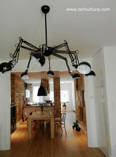 "Budapest designer Petra Nikoletti bought eight Ikea Forsa lamps and a salad bowl and had a locksmith precision fit them into a ""spider lamp"""