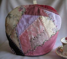 Crazy Quilt Tea Cozy in Rose and Lavender because crazy quilts tell stories and hot tea is one of the better stories.