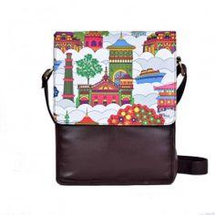Jalebi Namaste Sky-line Sling Bag : This Jalebi namaste Sky-line Sling bag characterises the colourful façade of a skyline.