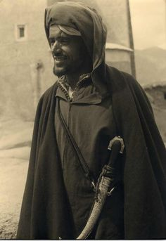 And this, right here, is why women dream of being captured by desert nomads and forced into a pillow-laden tent lifestyle...you know, if there were such a thing.  Bedouin sword, Morocco, circa 1930. Silver print. 25 x 35 cm.