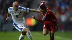 Lukáš Tesák of Slovakia in action with Pedro Rodríguez (R) of Spain during their UEFA EURO 2016 qualifier