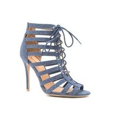 The ultimate versatile heel. Keep things dress down with this casual denim heel for a daytime look paired with cargo skinnies and a loose blouse. When it's time to hit the night scene, swap out your jeans for a flashy mini skirt and you're good to go! #cagedheels #fashion #style #newarrivals #style #denim #bluedenim #strappy