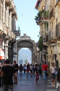 Wander the main street of Taormina from Porta Messina to Porta Catania