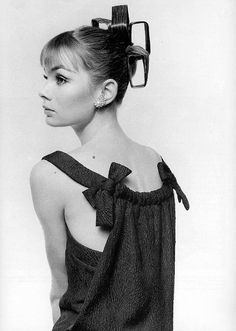 Jean Shrimpton is wearing Balmain's blistered silk dress with back panel, coiffure by Vidal Sassoon, photo by David Bailey, Vogue, March 1964
