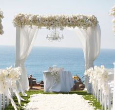 Wedding arch - white flowers, wood arch, fabric, ocean background - <3