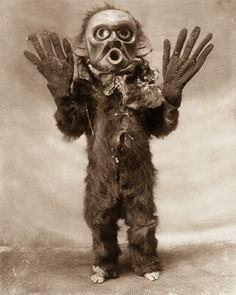 "1914 A Koskimo man dressed as Hami (""dangerous thing"") during a Numhlim ceremony. Image: Edward S. Curtis/Library of Congress"