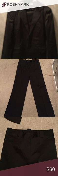 Black Suit This is for a suit; blazer and Pants. Pants are flat front and with pockets La redoute Other