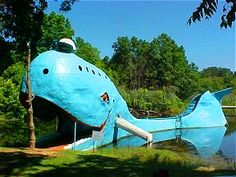 The Blue Whale    The Blue Whale has become one of the most recognizable attractions on old Route 66 in Oklahoma. Hugh Davis built it in the early 1970s as an anniversary gift to his wife Zelta. The Blue Whale and its pond became a favorite stop and swimming hole for both locals and travelers alike. Hugh was an entrepreneur in the grand old tradition of those roadside attraction proprietors of old. Over the years his park became a destination in itself.