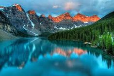 Taken at the peak of color during the morning sunrise at Moraine lake in Banff National park. Free art print of Moraine Lake Sunrise Colorful Landscape. Lago Moraine, Banff Canada, Alberta Canada, Banff Alberta, Parc National De Banff, Share Pictures, Canada Pictures, Canada National Parks, Sunrise Lake
