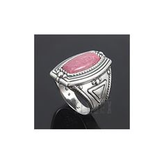 Material: .925 sterling silver Gemstone: 5/8 inch long x 1/4 inch wide genuine rhodonite Measures: 7/8 inch wide at widest point  Ring size: 6