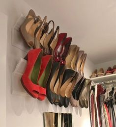 DIY Heel Wall Mount Closet getting tight? If you've got a collection of high heels, this might work for you! Crown moulding angled just right against a piece of base molding will hold your heels up and out of the way. They're easy to access and actually look quite nice displayed like this.