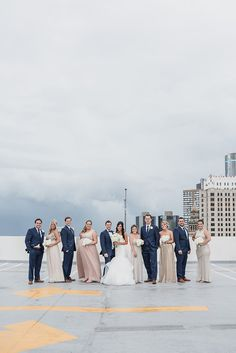 Classic navy suits for the groom and groomsman paired with an eclectic mix of bridesmaid dresses in gold, pink, blush, and champagne. Classic Birmingham, Michigan summer wedding at the Westin Book Cadillac in Downtown Detroit and Birmingham Community House in Birmingham, Michigan provided by Kari Dawson, top rated Metro Detroit Wedding and Engagement Photographer.
