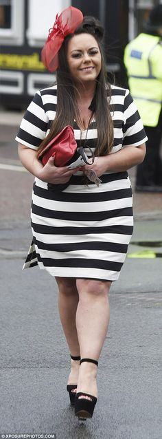 A racegoer opted for a relatively understated look in a black and white striped dress, whi...