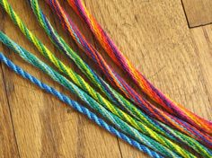 Spiral kumihimo braids with 12 to 28strands; uses embroidery floss & has instructions for making the braiding disk from card stock.  Easy to learn.  #handmade #jewelry #braiding