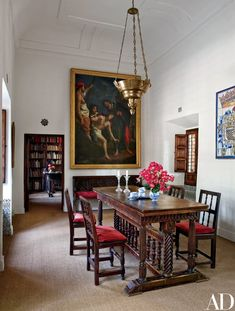 A work by the Mannerist painter Cristofano Allori dominates the dining room, which is furnished with a 16th-century Spanish table and 19th-century chairs | archdigest.com