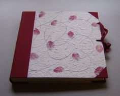 Photo Album - Handmade work    Dimension: 32 x 31 cm, 40 pages (80 front and back) of heavy ivory card stock with interleaved glassine sheets.   It's possible customize the album by choosing the color of the canvas, the kind of paper and the size.