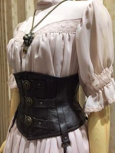 Everyday outfit idea for female pirates. Leather corsets and lace blouses with intricate detailed trimmings. Very light material.