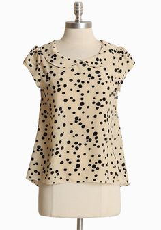 "Polished with a sophisticated collar and a chic black print, this cream top effortless transitions from office to weekend. Lightweight.  100% Polyester, Made in USA, 24.75"" length from top of shoulder"