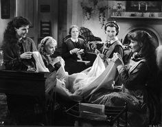 American actresses Jean Parker Joan Bennett Spring Byington Frances Dee and Katharine Hepburn sew in character on set as the March women in a still from Little Women