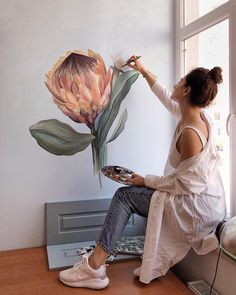 Artist and illustrator Lilit Sarkisian paints flower mural art that makes ordinary rooms bloom with personality.