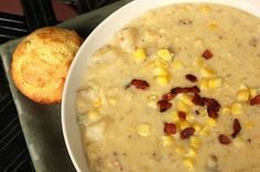 "Crockpot 'Corn & Potato Chowder' : 1/2lb bacon cooked crispy & crumbled, 5 med russet potatoes  (washed, NOT peeled, diced 1/4"" cubes). 2lbs (8C) frozen corn, 1 lg yellow onion chopped, 1C chopped celery, 6-8 cloves minced garlic, 1t season salt, 4C chicken broth, 2C heavy cream, salt/pepper to taste. Combine all EXCEPT cream in 7qt+ Crockpot. Cook low 10hrs / high 6hrs. Blend 1/2 soup w/ immersion blender, add cream, cook uncovered 15 more minutes. Garnish w/ shredded cheddar and green…"
